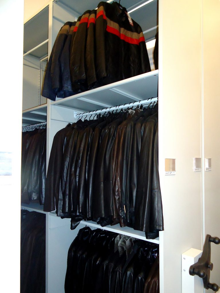 image of high density storage in retail setting:  hanging rods