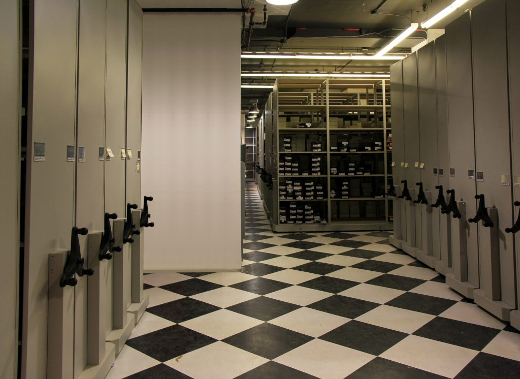 image of high density storage in a retail setting:  shelving and mechanical assist system
