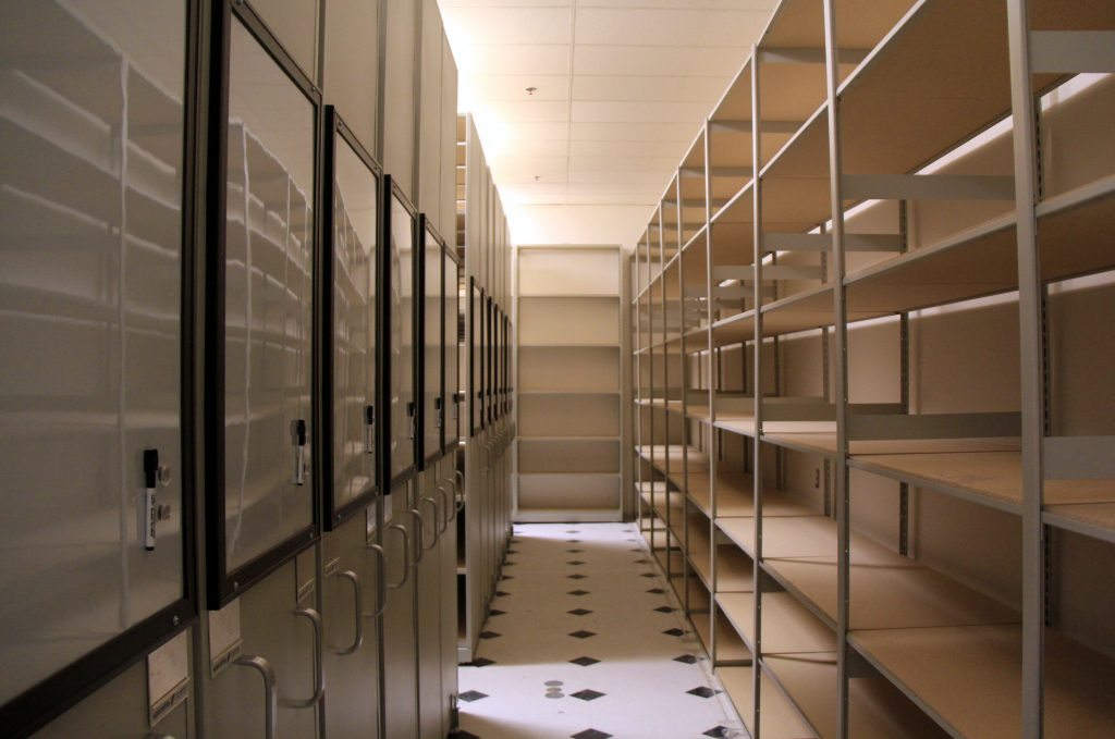 image of high density shelving and storage in a retail stockroom