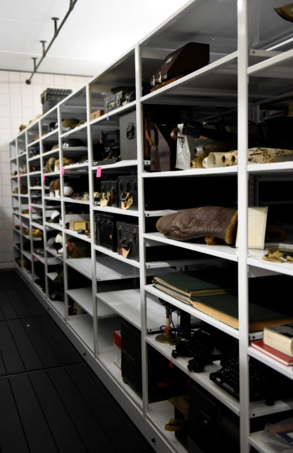 image of artifacts in high density storage unit at Canadian Warplane museum